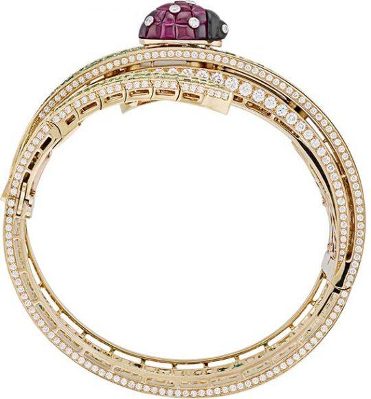 Secret de Coccinelle watch. Yellow, pink and white gold, diamonds, emeralds, Traditional Mystery Set rubies, tsavorite garnets, onyx, manual-winding mechanical movement.